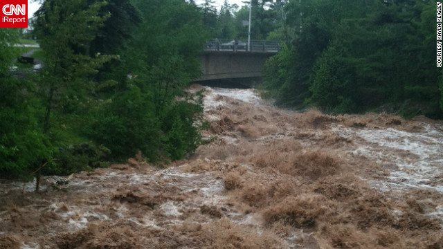 "Severe flooding in Duluth, Minnesota, in June destroyed roads and left neighborhoods underwater. ""We have not experienced anything like this in our community,"" said photographer and healthcare preparedness coordinator Kayla Keigley. ""Roads are destroyed. Neighborhoods are underwater. I am in shock and I work in the field of preparedness - this is something I work to deal with daily. Our community is in disbelief."""