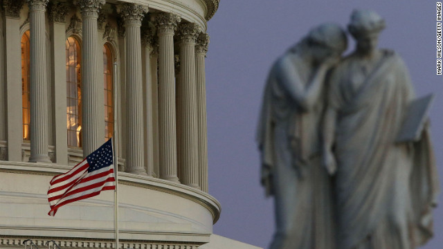 "A flag at the U.S. Capitol flies at half-staff after President Barack Obama ordered the action while speaking from the White House. Obama called for ""meaningful action"" in the wake of the school shooting."