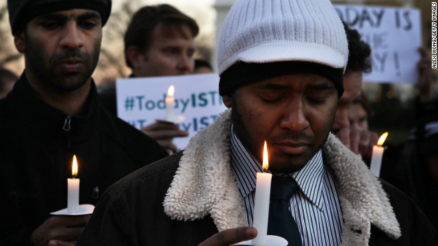 Faisal Ali, right, of Colorado Springs, Colorado, joins the vigil outside the White House.