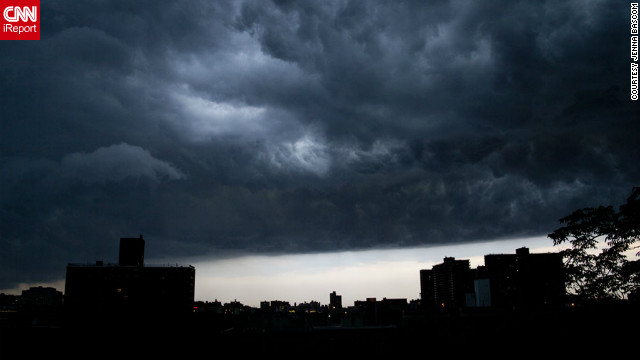 "Skies darkened over New York City as a storm moved into the area in July. ""The storm was pretty mild, but seeing it come through was amazing,"" said photographer Jenna Bascom at the time. ""Gorgeous clouds, great light."""