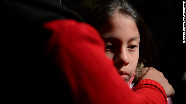 Cynthia Alvarez is comforted by her mother, Lilia, as people gather for a prayer vigil at St. Rose of Lima Roman Catholic Church in Newtown.