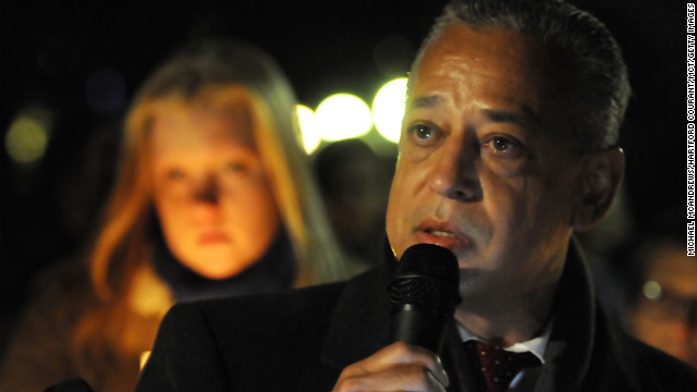 Hartford, Connecticut, Mayor Padro Segarra speaks emotionally about the students and teachers who died earlier in the day at Sandy Hook Elementary School in nearby Newtown at a candlelight vigil at Bushnell Park in Hartford on Friday.