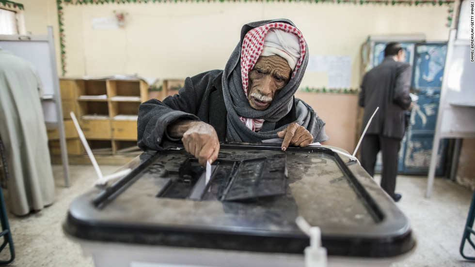 An Egyptian man casts his vote during a referendum on the new Egyptian constitution at a polling station on December 15, 2012 in Cairo, Egypt.