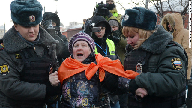 Russian police officers arrest an activist on December 15, 2012 in Moscow.