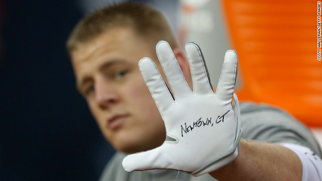 J.J. Watt of the Houston Texans shows his glove in remembrance of the victims before the start of a game against the Indianapolis Colts on December 16 in Houston.