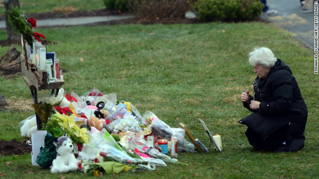 Parishioners pay their respects to the victims of the elementary school shooting in Connecticut.