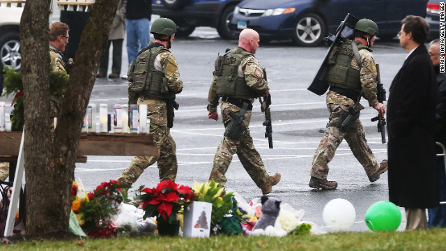 Connecticut State Police officers search outside St. Rose of Lima Roman Catholic Church in Newtown, Connecticut, on Sunday, December 16, after a threat prompted authorities to evacuate the building. Investigators found nothing to substantiate the reported threat, a police official said, declining to provide additional details. The church held Sunday services following last week's mass shooting at Sandy Hook Elementary School in Newtown.