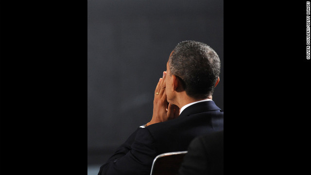 President Barack Obama waits to speak at an interfaith vigil for the shooting victims from Sandy Hook Elementary School December 16 at Newtown High School.
