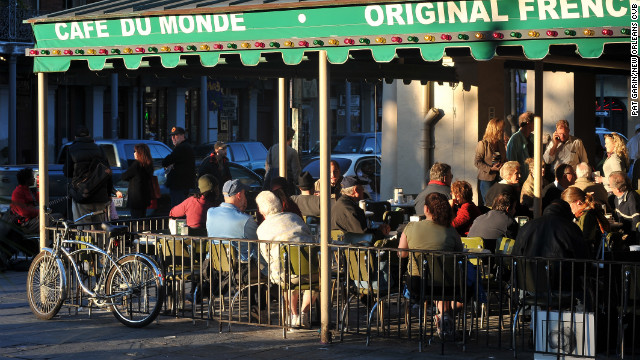 Visitors to the city now are likely to indulge in beignets at Cafe du Monde.