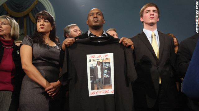 Chris Foye, whose son Chris Owens was killed by a stray bullet in 2009, stands with other survivors and family members of gun violence at Bloomberg's press conference on December 17 in New York.