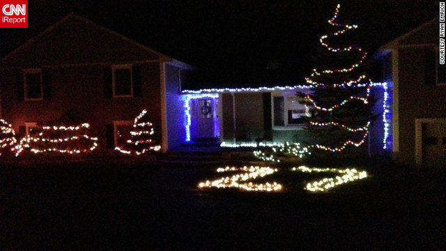 Ryan Emrich rearranged his house's Christmas lights to memorialize the 27 lives lost in Newtown. 