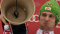 Marcel Hirscher of Austria celebrates with a cow bell he received during the podium ceremony of the men's slalom race at the FIS Alpine Skiing World Cup on January 8, 2012 in Adelboden.