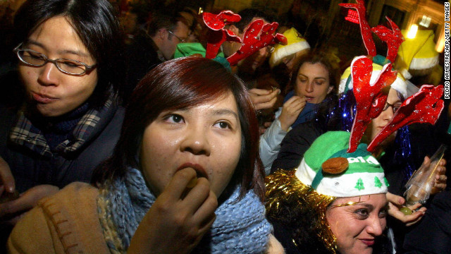 A crowd of people gathered in Puerta del Sol in Madrid stuff their faces with 12 grapes to celebrate the New Year, each representing a month in the year ahead. Similar grape-related larks are practiced in Mexico, Chile and Costa Rica