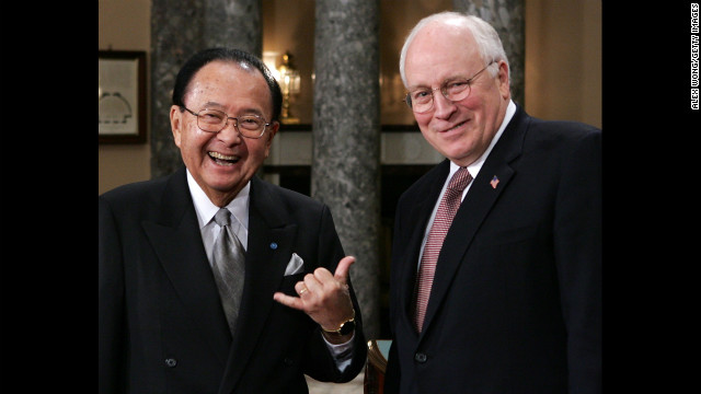 Inouye, left, poses for photographers with Vice President Dick Cheney during the reenactment of a swearing-in ceremony on January 4, 2005.