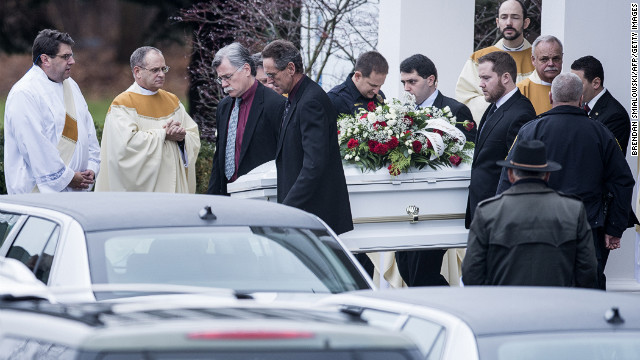 Pallbearers carry out James Mattioli's casket at St. Rose of Lima Roman Catholic Church after a funeral Mass on December 18 in Newtown. James, 6, was one of the 26 victims in the shooting at Sandy Hook Elementary School in Newtown. 