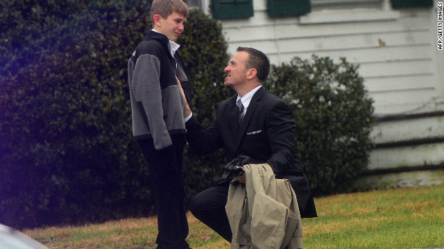 A man comforts a young boy after the funeral for Jack Pinto, 6, one of the children killed when Adam Lanza stormed their elementary school and claimed the lives of 20 children and six adults after killing his mother. Lanza turned the gun on himself as police closed in.