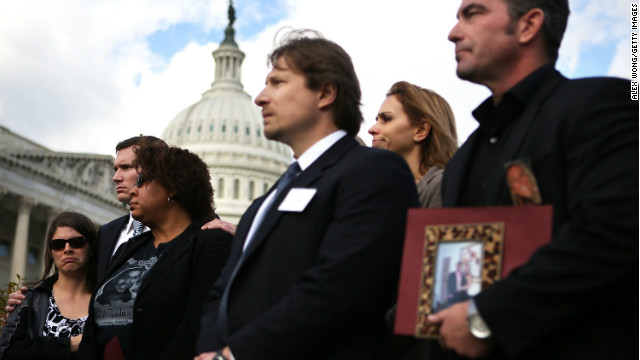 Survivors and family members of victims of gun violence listen during a news conference on Capitol Hill December 18.