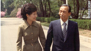 Park Geun-hye walks with her late father and former president Park Chung-hee in 1977.