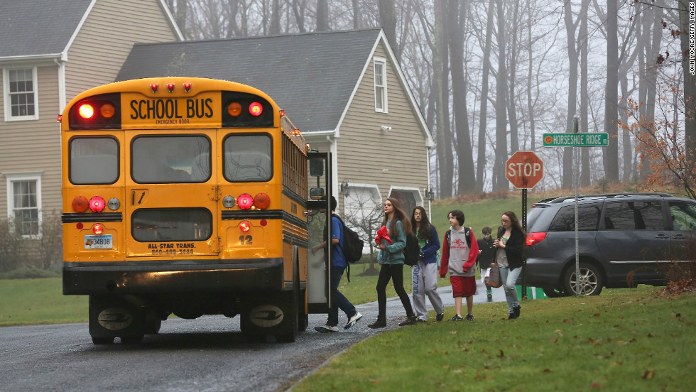 Children in Newtown, Connecticut, return to school on December 18, 2012, four days after the shooting at Sandy Hook Elementary School. Adam Lanza opened fire in the school, killing 20 children and six adults before killing himself. Police say he also shot and killed his mother in her Newtown home.