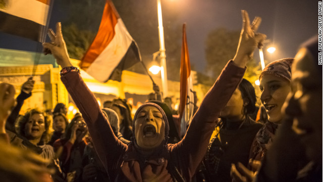 Protesters chant slogans during a demonstration at the Presidential Palace on December 18 in Cairo.