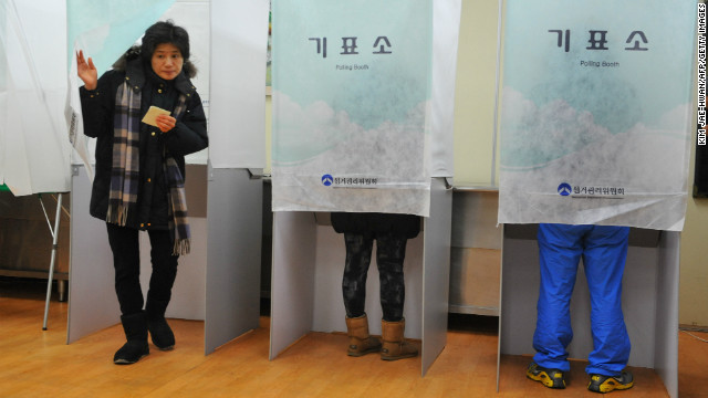 A woman leaves a polling booth in Seoul on Wednesday after casting a vote in South Korea's presidential elections.