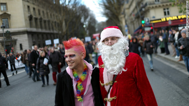 A man dressed up as Santa Claus appears at a demonstration in Paris for the legalization of same-sex marriage on December 16.