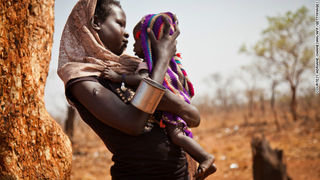 A woman and her child from the Nuba Mountains wait outside the Yida refugee camp registration center. &quot;There is no such thing as pens or notebooks for the thousands of children in need of an education at Yida,&quot; says Nyange.