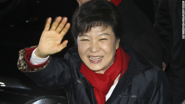 President-elect Park Geun-Hye, South Korea's first female president, waves to supporters after being declared the winner on December 19, 2012 in Seoul. She will become one of several female leaders in Asia, as well as the world.