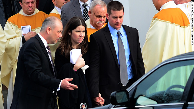 Richard and Krista Rekos leave after a funeral service for their 6-year-old daughter, Jessica, at Saint Rose of Lima Church on Tuesday, December 18, in Newtown. Jessica was one of 20 children killed in last week's school shooting.