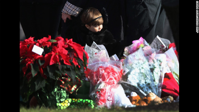  A child stands next to a makeshift memorial for Jessica Rekos following her funeral on December 18.