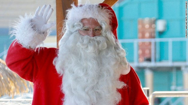 A man dressed in a Santa Claus costume poses with a sea lion at the animal exhibition park Marineland, in France, on December 19.