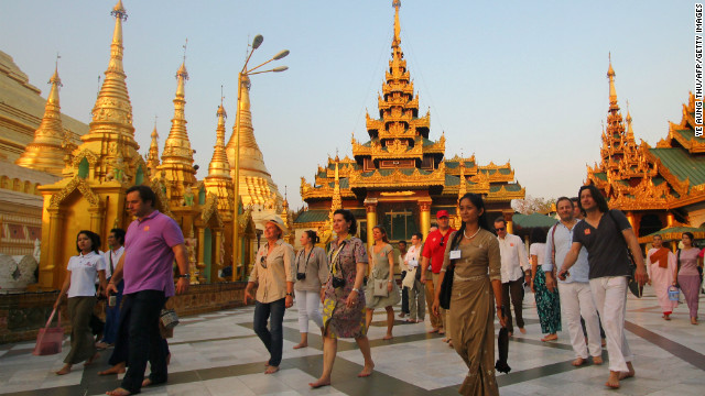 Tourists walk around the Shwedagon Pagoda in Yangon in April. The tourism industry is set for expansion.