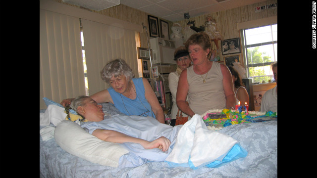 Family and friends gather for Edwarda's birthday in 2004.