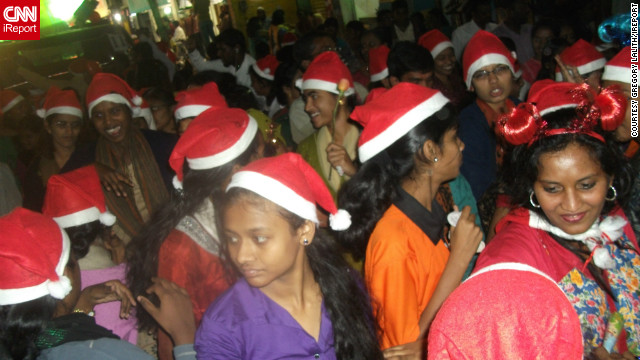 <a href='http://ireport.cnn.com/people/lalith1'>Gregory Lalith</a> took this image of festive revellers at the annual Christmas carnival in his hometown of Hyderabad, India<!-- -->.</br><!-- --> </br> Trucks, cars and all manner vehicles are transformed into festively themed parade floats for the event, before setting off along the city's main thoroughfares and neighborhoods, he said.