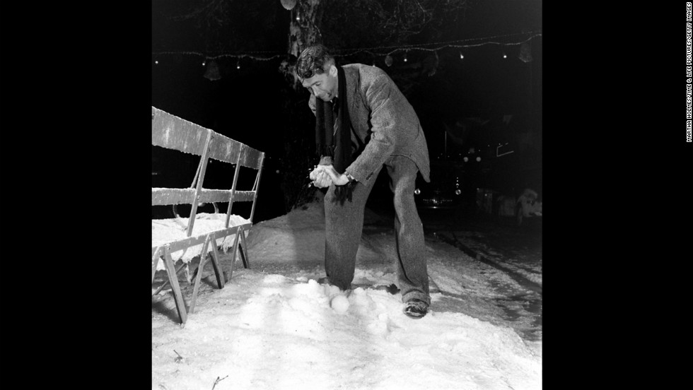 Actor Jimmy Stewart packs a snowball on the set of &quot;It's a Wonderful Life.&quot; In the 1946 holiday classic, an angel shows frustrated businessman George Bailey what his community would have been like without him.