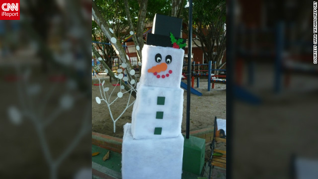 "<a href='http://ireport.cnn.com/people/Statham'>Sarah Tatham</a> is a Canadian living in Barranquilla, Colombia. This picture of a cardboard snowman reflects her longing for home during Christmas. ""I love living in the tropics, but at this time of year I really miss seeing the lights and snow, and seeing the hustle and bustle as people buy their gifts,"" she said."