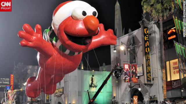 "<a href=''>Donna Clare</a> captured this fun shot of a giant inflatable Elmo -- of the popular children's TV show, Sesame Street -- floating high above the Hollywood Christmas Parade. ""The event, as expected was a Hollywood affair, complete with lots of red carpet and lots of celebrities,"" she said. ""[It] felt like a movie premiere more so than a parade."""