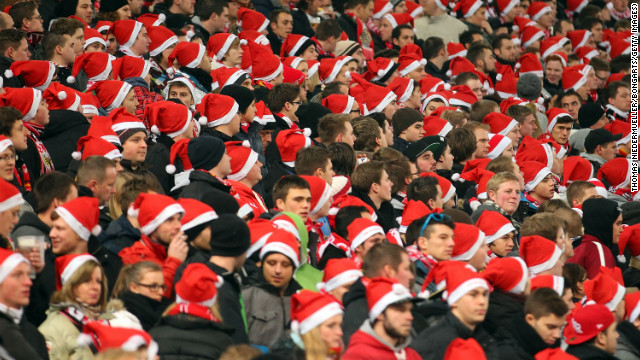 Stuttgart fans don Santa hats during a German Cup match between VfB Stuttgart and 1. FC Köln on December 19 in Stuttgart, Germany.