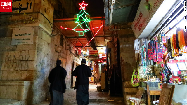 "This photo of a couple of priests walking through the Christian Quarter in Jerusalem was taken by James Cheatham, who has lived and worked on and off in the city since 2002<!-- -->.</br> <!-- --> </br> ""When I was walking through the Christian Quarter, several of the shops had Christmas music playing such as Bing Crosby (White Christmas), Nat King Cole (Chestnuts Roasting On An Open Fire), and O Holy Night, amongst others which really added to the atmosphere,"" said the native Californian."