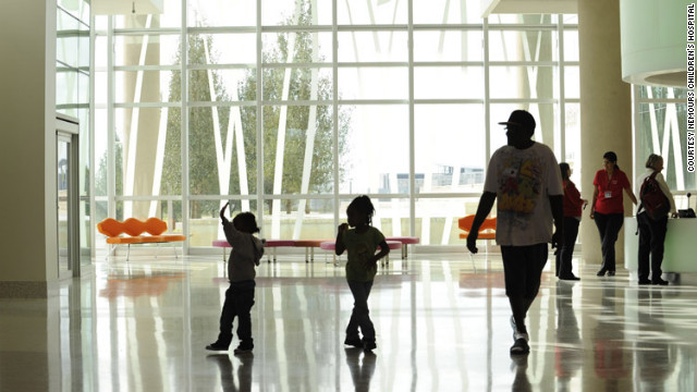 Families walk through the lobby of Nemours Children's Hospital in Orlando, Florida, on opening day in October.