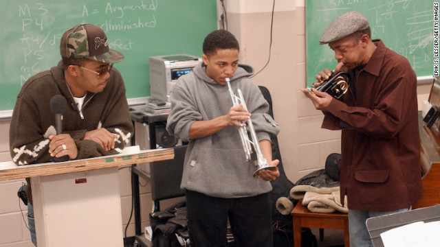 "Nas and Olu Dara, right, play music with student George Kadir Muhammad during a jazz class at Morehouse College in 2005. The event was part of mtvU's ""Stand In"" show where surprise professors took over university classes."