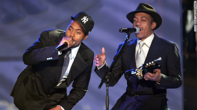 Nas and his father, Olu Dara, perform during the VH1 Hip-Hop Awards in New York City in 2004. Nas' father is a jazz cornet player and is featured on the rapper's 2004 track, &quot;Bridging the Gap,&quot; along with a Muddy Waters sample.