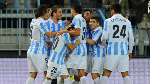 Spanish club Malaga, which reached the quarterfinals of the Champions League in 2013, was banned from European competition by UEFA for a year after failing to pay its bills.
