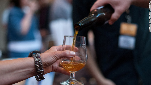 People sample beers at Savor, a craft beer show, at the National Building Museum in Washington in June. 