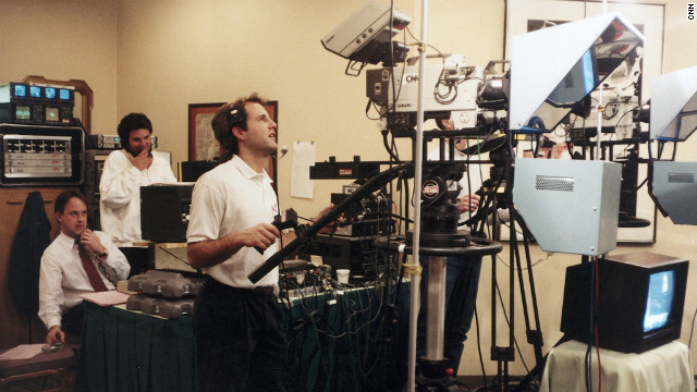 In an undated photo, Walton, from left, Mike Iachino and John McAfee are on the job for Turner Sports.