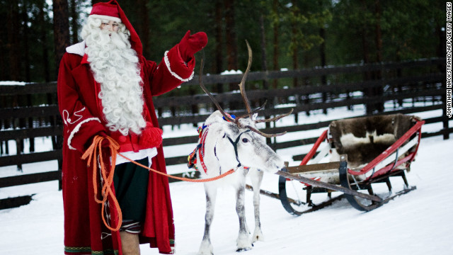 Santa Claus, or his spitting image, posing with an authentic reindeer in Finland last year.