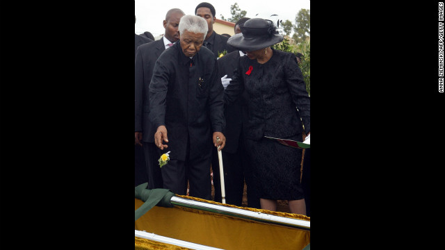 Mandela throws a rose on the grave of his son Makgatho in Qunu on January 15, 2005. He disclosed that his son had died of AIDS and said the disease should be given publicity so people would stop viewing it as extraordinary.