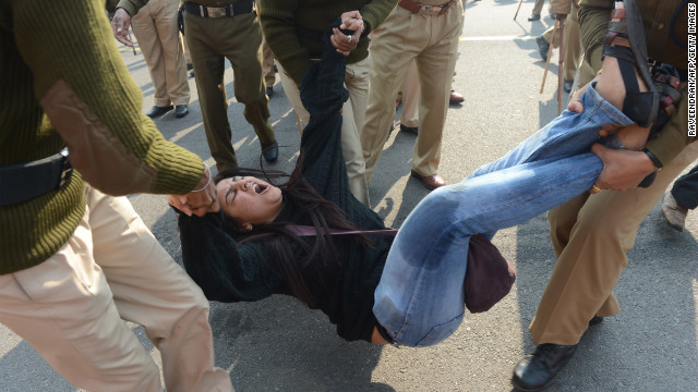 Police arrest a demonstrator during a protest on December 22. Sunday's attack sparked furious protests across India, where official data show that rape cases have jumped almost 875% over the past 40 years -- from 2,487 in 1971 to 24,206 in 2011.