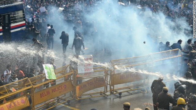 Police unleash water cannon and fire tear gas towards demonstrators on December 22.