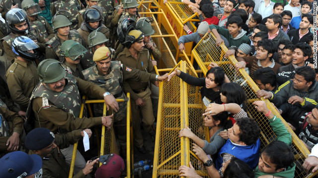 Demonstrators push against a police barricade on December 22.